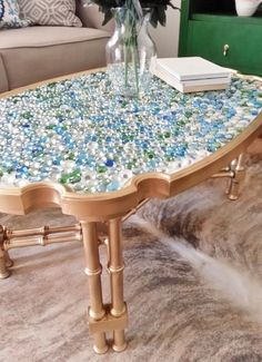Coffee table makeover with marbles from the dollar store!