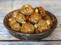 These pork meatballs are served with a quick and easy sauce. Garlic, scallions, honey, and optional cilantro provide flavor.