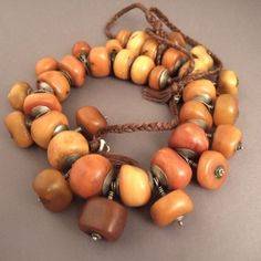 Mauritania | Amber and silver necklace | This Moorish (35 pearls in 2 ranks) necklace is worn for their prophylactic virtues or more generaly because it represents prosperity and gives protection to the wearer.The real amber is a fossilized resina from pin tree ( about more than 60 millions year old) mostly coming from the Baltic sea.      Weight:233,6gr