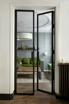 A green sofa for a gray apartment Un canapé vert pour un appartement gris Interior Design Minimalist, Green Sofa, Steel Doors, Windows And Doors, Interior Inspiration, Interior Architecture, New Homes, House Design, Home Decor