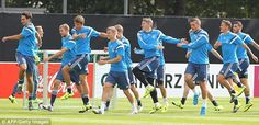 The Germany players go through their warm-up routine on the practice field in Frankfurt ...