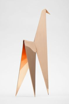 Home decoration, a minimal sculpture - animal figurine - inspired by Japanese origami art but made of a very thick metal sheet. Here shown in rose gold copper finish.