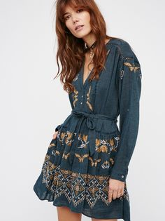 You Give Me Butterflies Dress | Beautiful embroidered dress featuring cute crochet accents and front button closures. Lovely bohemian feel with an easy tie belt at the waist. Lined.