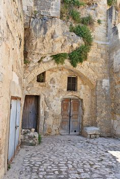 Matera, Basilicata, Italy ... How this fills my heart with longing. Don't know what it is about old places, stone, doors, windows, and of course Italy that makes my heart beat faster as if I'm seeing a long lost lover.