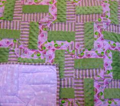 Heartly Pink and Green  - This patchwork quilt will warm your heart as it features blocks of varying shades of soft pink in 100 percent cotton baby flannel mixed with soft pastel green minky fabric. Together they are hand quilted to be both durable and adorable.