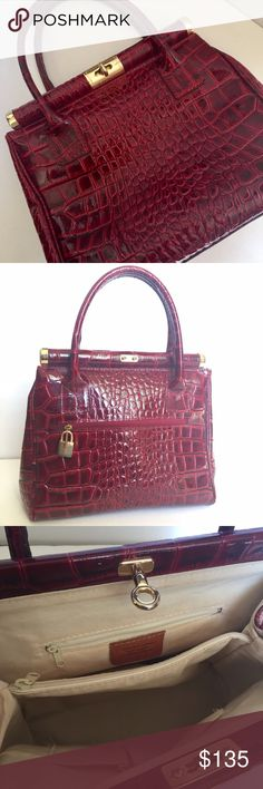 Red Italian Leather Handbag Gorgeous ARTE DEL CUOIO red crocodile embossed genuine Italian leather handbag  *Made in Italy   *Regal gold embellishments   *Gold lock & key!   *Two zippered interior pockets   *One exterior zippered pocket   *Two interior side pockets   *Canvas interior in good shape   *Gold studs on bottom of purse to keep the leather from touching surfaces  *Super chic! Looks like a $500 designer bag! Bags
