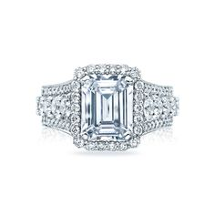 Hailing from the RoyalT Fancies collection, this stunning emerald cut Tacori engagement ring is sure to take her breath away. With gorgeous diamonds blooming the crown, and thick ceilings scattered with brilliant round diamonds, this ring is truly one for the ages. This majestic beauty is sure to be passed down for generations to come.