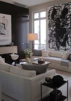 Neutral living room with a black accent wall and accessories and abstract art Living Room Inspiration, Interior Inspiration, Living Room Designs, Living Spaces, Living Rooms, Piece A Vivre, Contemporary Interior Design, Interior Exterior, Living Room Interior