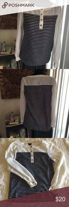 🕶Ann Taylor Navy and White Striped Blouse🕶 100% Polyester  24 inches in length  19 inches across chest (pit to pit) The white sleeves and shoulders are a thinner gauzier material than the striped part. The buttons show a little wear, but nothing too bad. As always, ask any questions in the comments and bundles of 3+ are 15% off! Ann Taylor Tops Blouses