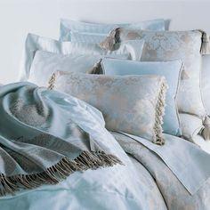 Anichini's Mario Celestine Blue Bed topped with a Taormina Italian Merino Wool Throw
