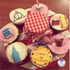 Birthday cupcakes for one of my favourites with all of her favourites!! #Garfield #bluebottle #bluebottlecoffee #calvinandhobbes #deathlyhallows #harrypotter #hp #hpfan #enidblyton #famousfive #cake #candle #garfieldthecat #atyummy #customisedcupcakes #cupcakes #birthday #cakejar #cakeinajar #checks #stripes #balloons #caramel #birthdaycake #fondant #customised #happybirthday