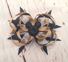 A personal favorite from my Etsy shop https://www.etsy.com/listing/585995514/minnie-mouse-hairbow-black-gold-minnie