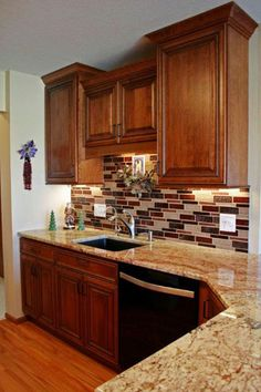 Kitchen remodel in Marion, IA. Designed by Donna Barnes with Ogden & Adams Lumber in Cedar Rapids, IA.  Fieldstone Cabinetry Reading door style in Cherry finished in Toffee with Chocolate Glaze.