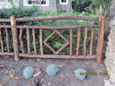 rustic tree limb fence