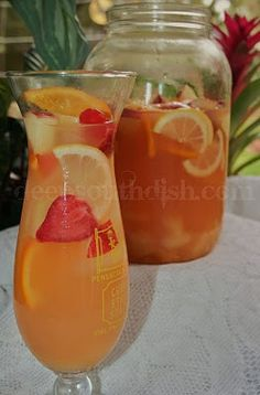 Pineapple Lemonade Sangria- A blend of white wine, lemon, pineapple, orange, apple and strawberries, it's a perfect party cocktail for spring and summer!