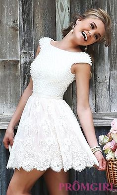 Short Ivory Dress with Cap Sleeves by Sherri Hill–Rehearsal Dinner.