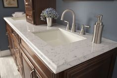 silestone lyra is a quartz that looks like marble but is more durable as shown with a paint colour like benjamin moore dior gray on this bathroom vanity