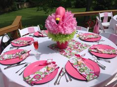 DIY flamingo centerpieces for Lilly Pulitzer summer bridal shower. Bought flamingos at Lowes. Set them in pink pots from Hobby Lobby. Added two puffs from Party City. Very easy!