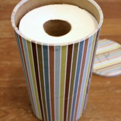 Cover an empty oatmeal canister in pretty paper and use it to store toilet paper in a small bathroom!