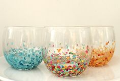 """DIY Knockoff Anthropologie Confetti Tumblers    Dollar store + acrylic paint + clear nail polish = Knockoff Anthropologie Confetti Tumblers    Here's the thing about Anthropologie; everything is gorgeous. But buying one thing means Visa ain't getting paid and my landlord is going to be getting an awkward """"So, here's the deal..."""" call. So I am unaba"""
