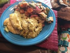 Baked & rice in enchilada sauce w/streamed veggies