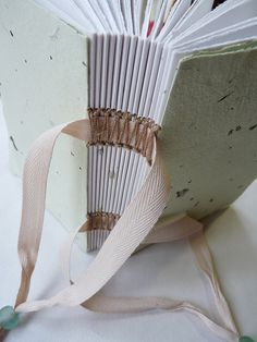 sewing on tapes book binding by immaginacija