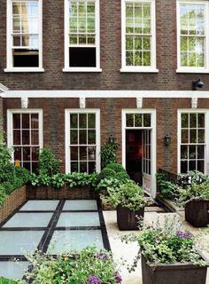 brick color plus trim color  Contemporary Outdoor Space by Shelton, Mindel & Associates via @Architectural Digest #designfile