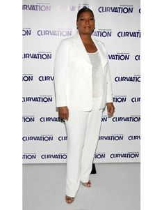 Queen Latifah A sleek, streamlined suit will never fail you. Your jacket should be tailored and trim and hit at the hips. Anything oversize won't look sharp. Straight-cut pants that fall to the bottom of your heel look best. Dark colors    - HarpersBAZAAR.com