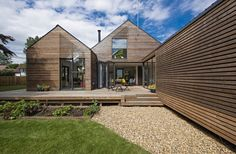 Olsen UK supplied all the doors & windows to the project with Sunflex folding, sliding doors and Euro Alu timber windows with aluminum cladding. Aluminium Front Door, Aluminium Cladding, Timber Windows, Windows And Doors, Interior Cladding, Timber Architecture, Front Door Design, Timber Frame Homes, Roof Light