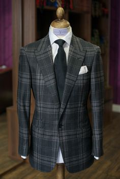 Charles Campbell Bespoke: Here we have a fantastic single breasted peak lapel dark grey check suit with white shirt and black silk tie.