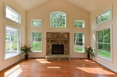 Daventry Model - Beautiful custom home. Living room with big windows, natural light, and a stone fireplace. Home, Stone Fireplace, Custom Homes, Luxury, Windows, Interior, House, Luxury Living, Room