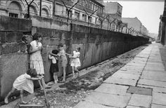 Children playing by the Berlin Wall. Taken in 1962 by the, Grandfather of Street Photography, Henri Cartier-Bresson.