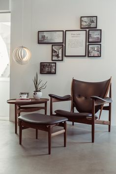 The iconic Chieftain Chair, designed by the danish designer Finn Juhl in 1949, completed with the footstool and the cocktail table, and produced by Onecollection.