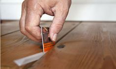 Insulating and draughtproofing floorboards with Stop-gap.