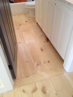 I like how they did the transition into bathroom with board laid opposite flooring direction in doorway