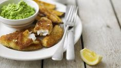 Lemon sole goujons with mushy peas and sweet potato chips