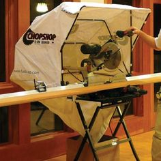 "FastCap ChopShop Saw Hood Heavy-duty water-resistant nylon hood creates a shell around chop saws, miter saws, lathes etc. Collapsible frame. Hood dimensions are 42""W x 30""D x 31""H. Includes mounting hardware, but no shop vac or dust collection hookup. Just empties into a box."