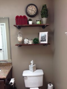 Shelves above the toilet. Obtained all the supplies from Home Depot for around $50. Just some black iron pipe, floor flanges and end cap with some stained pine across the top. Only took a few hours over the weekend!