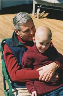 Bobby Menges was diagnosed with stage IV neuroblastoma when he was 5 years old. He is now 14 and healthy. This photo, sent by his mother, Elizabeth Menges, was taken with his late grandfather in 2004 after a stem cell transplant.