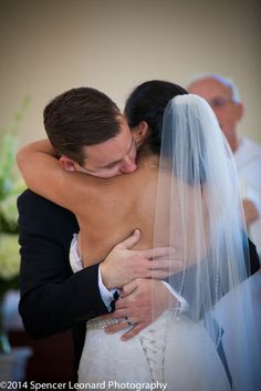Beautiful photo from the ceremony of the bride and groom! Photo by: Spencer Leonard Photography