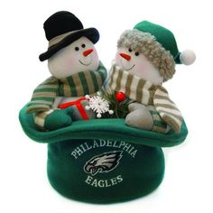 "$34.99-$43.75 12"" NFL Philadelphia Eagles Snowmen Top Hat Table Christmas Decoration - Philadelphia Eagles Snowmen Table Top Decoration Item #29319 Officially licensed merchandise Decoration includes a snowman couple sitting in a top hat, wearing the official team colors and logo of your favorite team  Additional product features: Dimensions: 12"" x 12"" Material(s): cotton blend http://www.amazon.com/dp/B003M5W3AK/?tag=pin2wine-20"