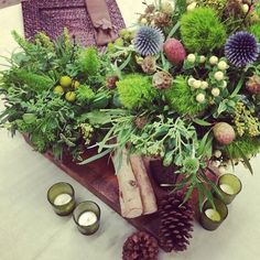 fabulous vancouver florist Another day another #sample #centrepiece #table. #westcoast #green #wood #thistle #berries #dianthus #sedum #pinecones #vancouverevents #vancouver #eventlife #flowers #florist  #vancouverflorist #vancouverflorist #vancouverwedding #vancouverweddingdosanddonts