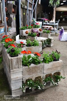 Cinder block chairs, with plenty of blooms were the perfect garden companions. I could totally see this working outdoors! When you want to sit, carry your cushy pillows with you! I sooooo loved these!