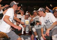 Members of the Penn State Nittany Lions celebrate as captain Travis Foltz holds the trophy after the Nittany Lions defeated the Pepperdine waves three sets to one to win the 2008 NCAA National Volleyball Championship Final at the Bren Events Center on May 3, 2008 in Irvine, California.