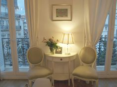 photo by michele #hellolovely #hellolovelystudio #apartment #paris  #frenchchairs #balcony