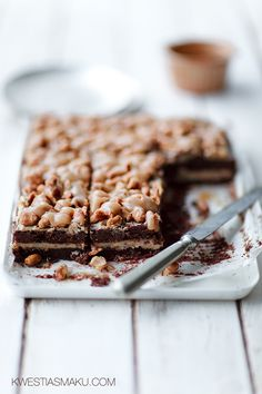 chocolate brownie cake with caramel and roasted ground peanuts drowned in caramel mascarpone icing