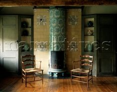 Ceramic tiled wood burning stove in Arts and Crafts  interior with antique wooden carvers
