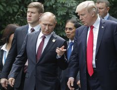 DA NANG, VIETNAM - NOVEMBER 11, 2017: Russia's president Vladimir Putin (L front) and US president Donald Trump before a photo session of world leaders on the closing day of the 25th APEC Summit. Mikhail Metzel/TASS (Photo by Mikhail Metzel\TASS via Getty Images) via @AOL_Lifestyle Read more: https://www.aol.com/article/news/2017/11/12/trump-distances-himself-from-remarks-on-putin-over-election-meddling/23274550/?a_dgi=aolshare_pinterest#fullscreen