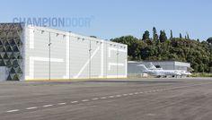 Image 23 of 35 from gallery of Hangar / Comte & Vollenweider. Photograph by Luc Boegly Le Hangar, Exterior Doors, Jumbo Jet, Garage Doors, Construction, Hangars, Aviation, Architecture, Gallery
