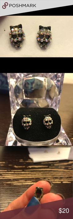 Betsey Johnson Skull Earrings Super cute! Opal colored stones really catch the light and they are wearing black bows on their heads. Really fun. The inside part you can't see has some discoloration. Betsey Johnson Jewelry Earrings